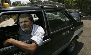 Morsi Drives a Cab