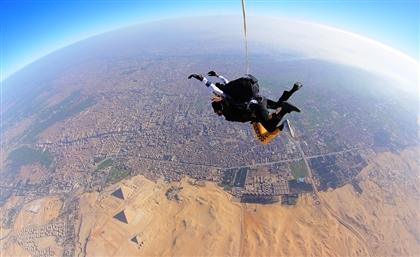 VIDEO: 60 International Skydivers Jump Over Pyramids