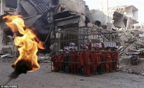 Syrian Children Recreate ISIS Videos to Protest Assad