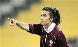 First Female Football Coach