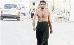 Half-Naked Man Wandering Mecca