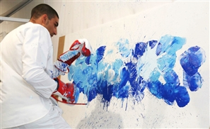 Egyptian Boxer Becomes a Worldwide Sensation Making Art by Punching Walls