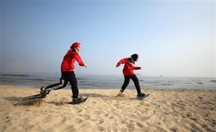 Special Olympics Athletes Use Sand to Train for Snowshoeing Tournaments